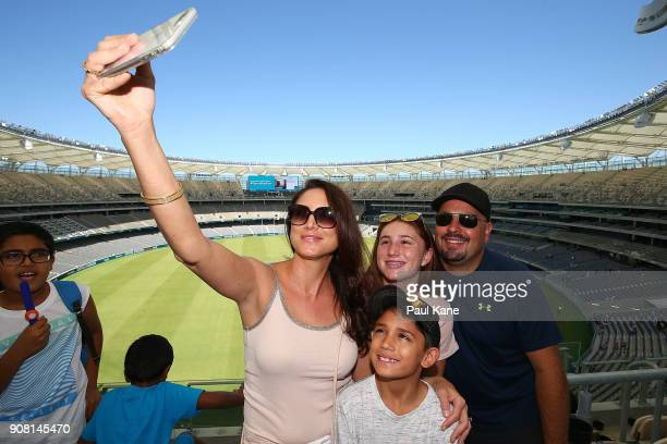 A family pose to take a selfie at Optus Stadium on January 21 2018 in Perth Australia The 60000 seat multipurpose Stadium features the biggest LED...