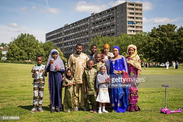 A family poses for a portrait as they celebrate the festival of Eid at Southwark Eid Festival in Burgess Park on July 6 2016 in London England...
