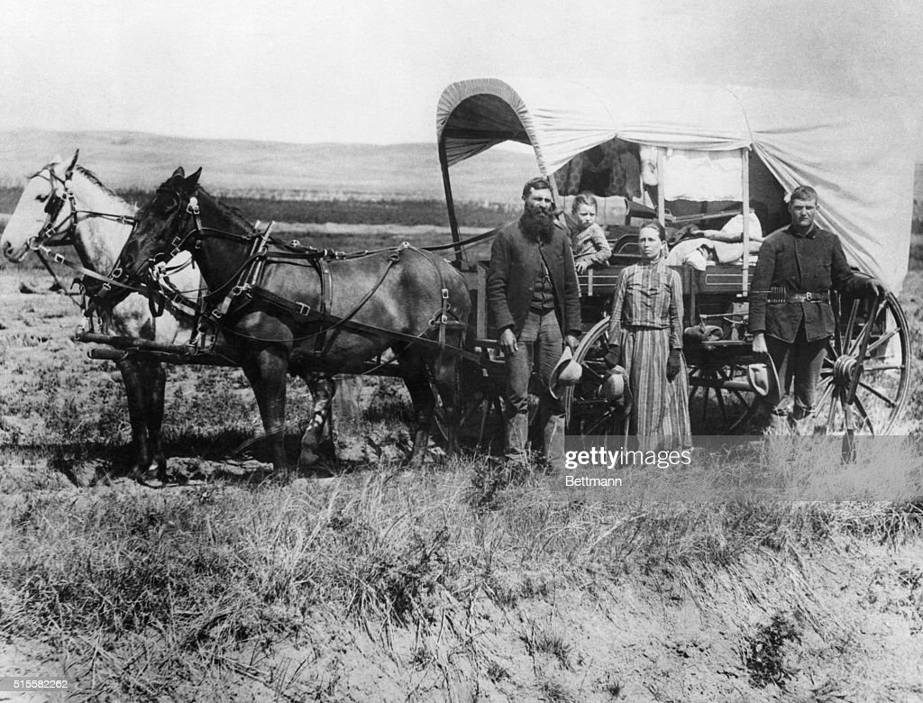 Emigrants Moving with Covered Wagon : News Photo