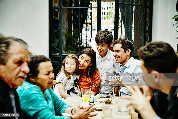 Family posing for photo during dinner party