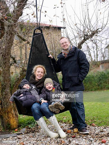 Family posing in garden