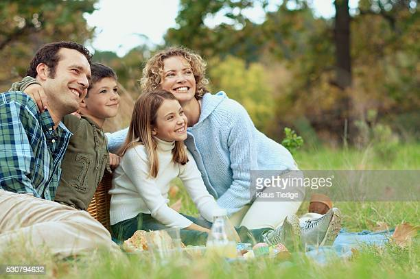Family posing in park