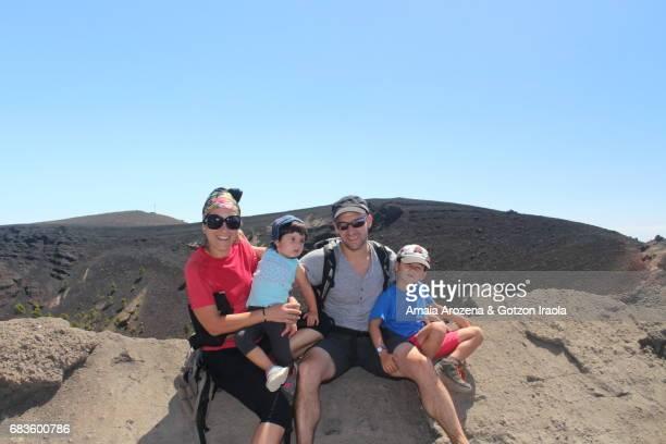 Family posing in San Antonio volcano's crater in Fuencaliente. La Palma island, Canary islands