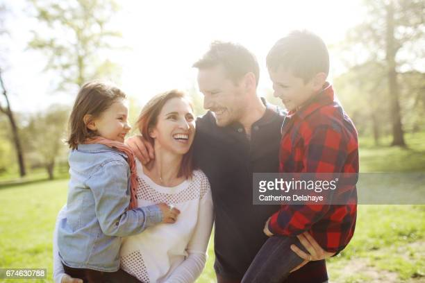 A family posing together in a park