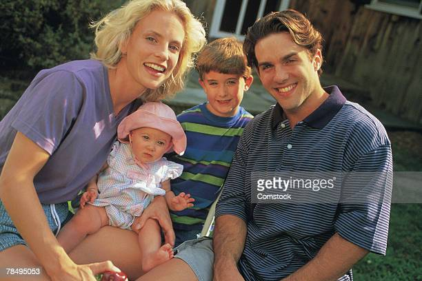 family posing together - 1990~1999年 ストックフォトと画像