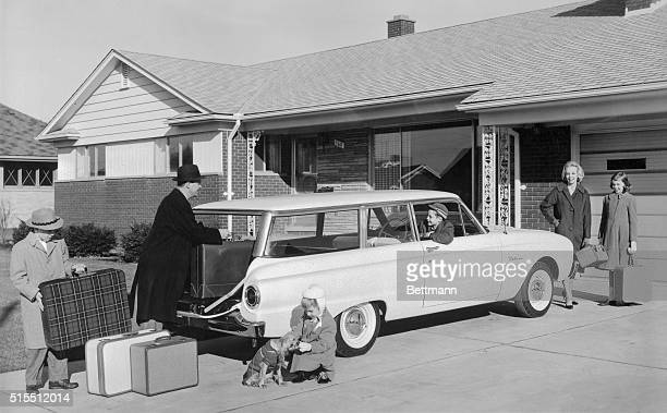 Family prepares to go on a trip in their 1960 Ford Falcon