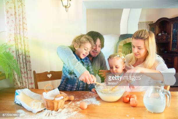 Family Preparing a Cake Together