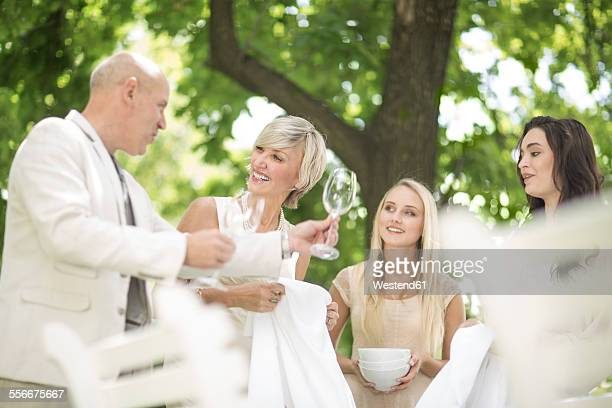 Family preparing a table outside