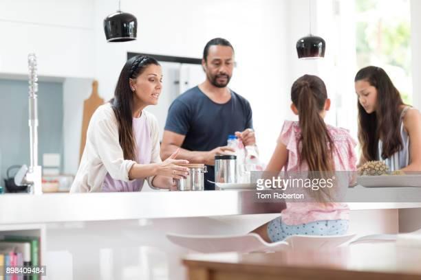 Family preparing breakfast in modern kitchen