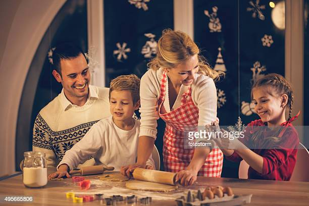 Family preparing Christmas cookies together