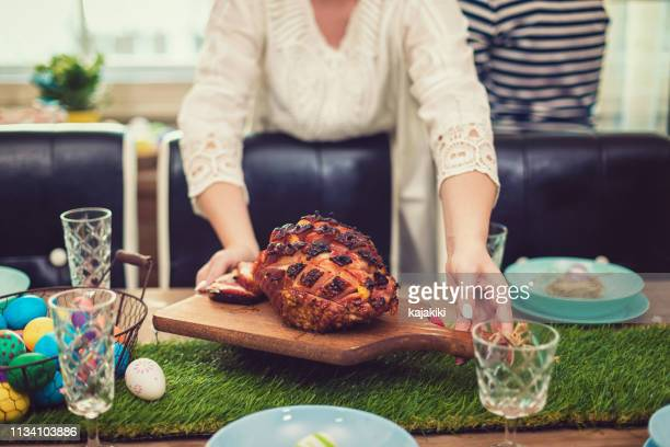 family preparing dining table for easter - easter flowers stock pictures, royalty-free photos & images