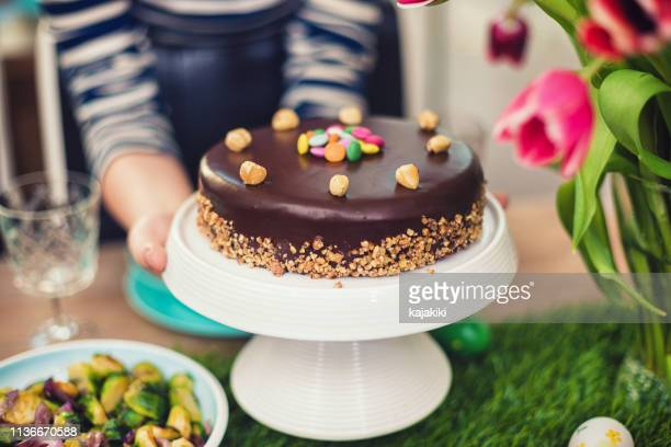 family preparing dining table for easter - easter cake stock pictures, royalty-free photos & images