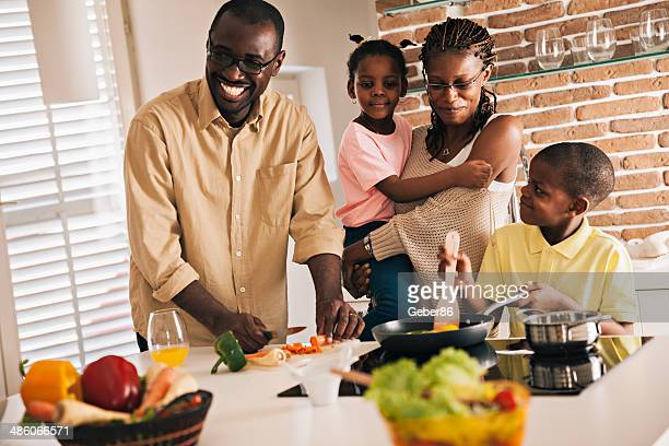 family preparing food - black family dinner stock photos and pictures