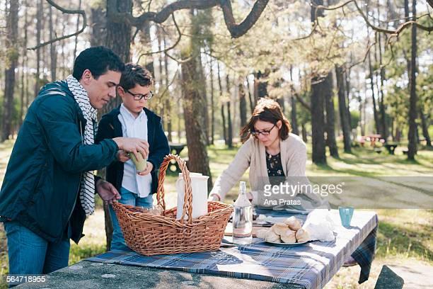 Family preparing for breakfast in forest