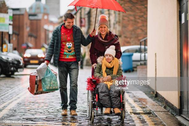 family preparing for christmas - epilepsy stock pictures, royalty-free photos & images