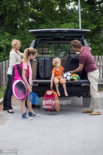 Family preparing for road trip