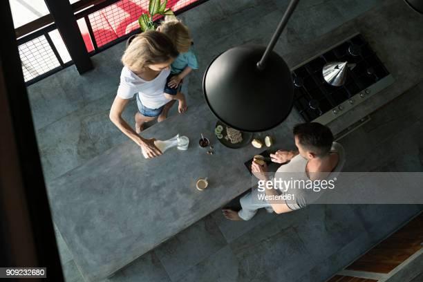 Family preparing healthy breakfast in comfortable kitchen