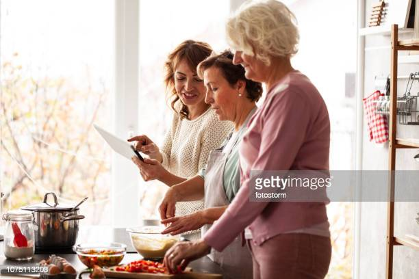family preparing lunch - great grandmother stock pictures, royalty-free photos & images