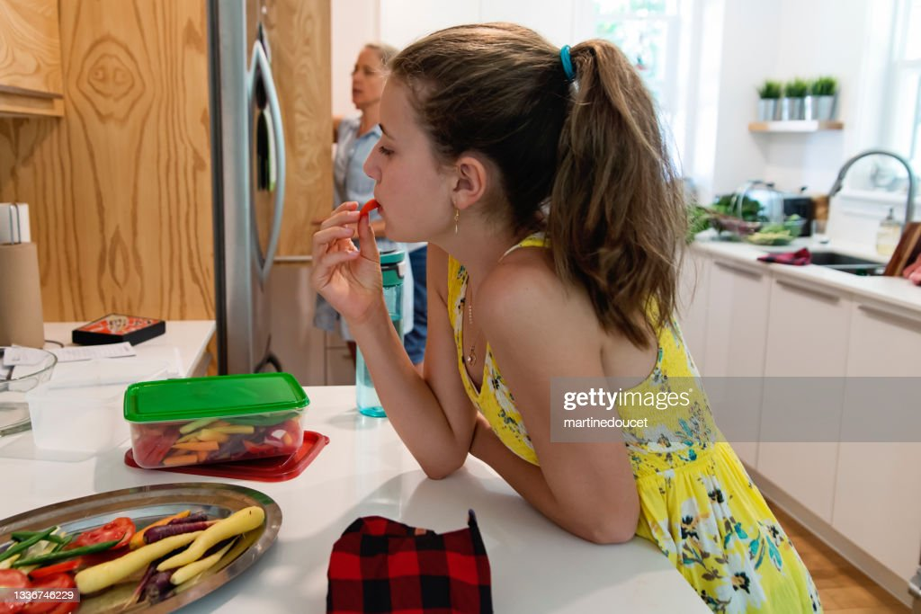 Family preparing lunch with eco-friendly food wrap. : Stock Photo