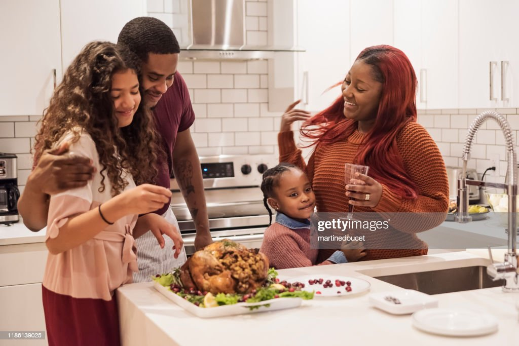 Family preparing Thanksgiving dinner. : Stock Photo