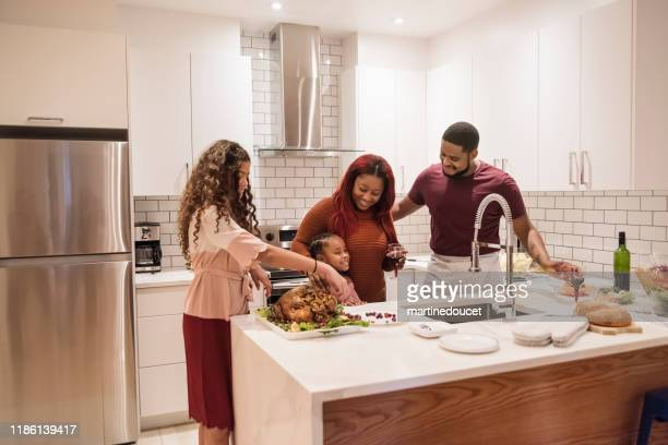 """family preparing thanksgiving dinner. - """"martine doucet"""" or martinedoucet stock pictures, royalty-free photos & images"""