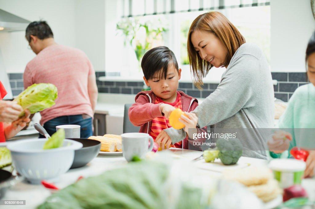 Family Preparing Vegetables for a Stir Fry : Stock Photo