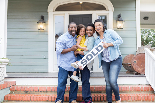 Family proud of their new home 936927992