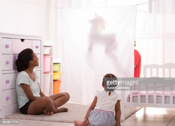 family puppet show time. - actors at home stock pictures, royalty-free photos & images