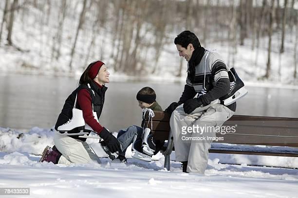 Family putting on ice skates