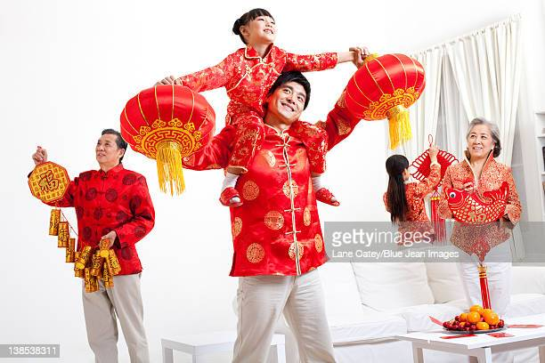 Family putting up Chinese New Year decorations