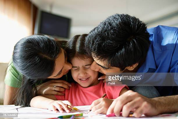family quality time - indian girl kissing stock photos and pictures