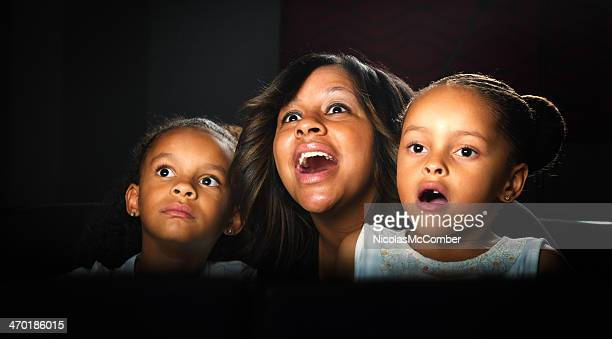 family reacting to big movie surprise - redoubtable film stock photos and pictures