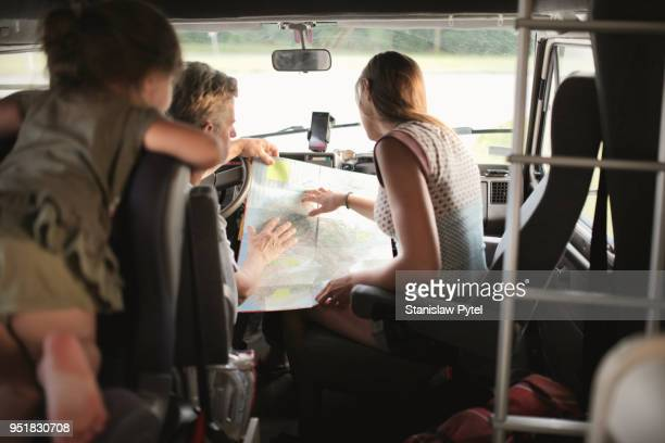 Family reading map in campervan