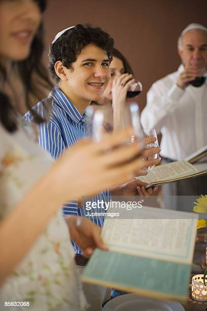 Family reading out of the torah and drinking wine