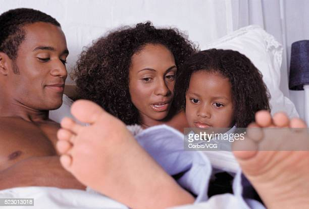 family reading - black male feet stock photos and pictures