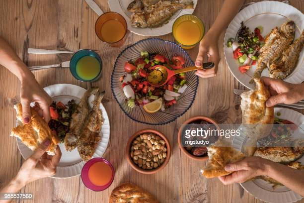family ready for i̇ftar meal in ramadan - iftar stock pictures, royalty-free photos & images