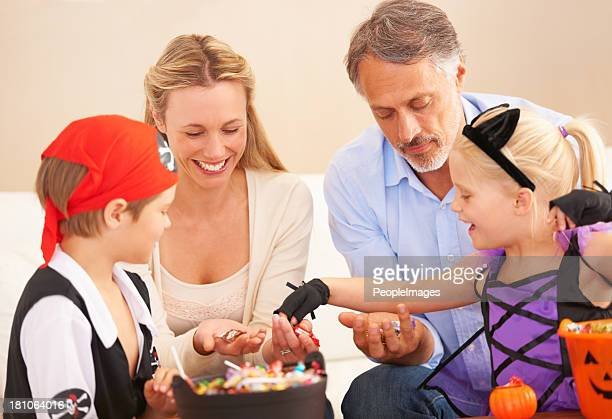 family ready to feast - halloween candy stock photos and pictures