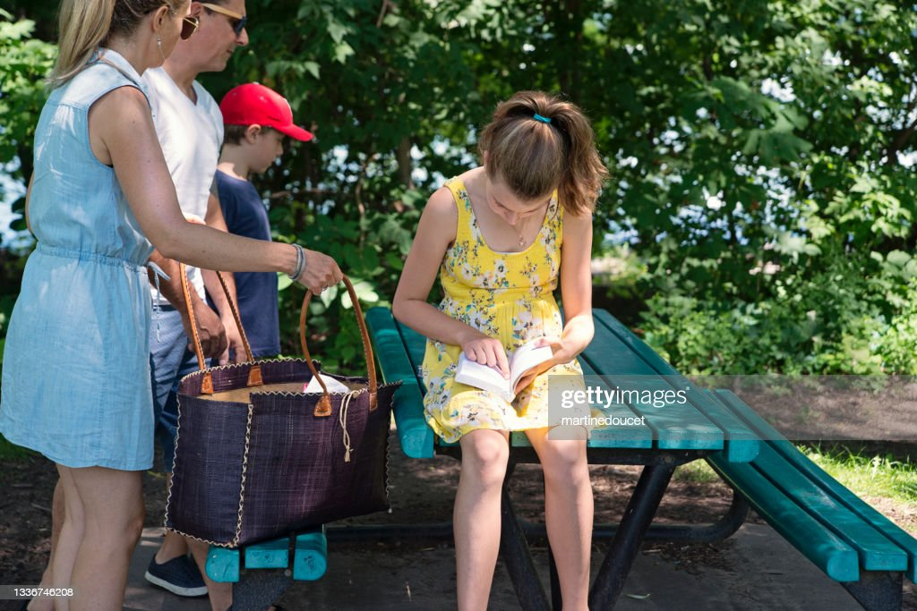Family ready to have a picnic in public park in summer. : Stock Photo