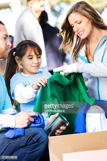 Family receiving clothing at charity event