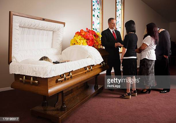 family receiving guests at a funeral - funeral stock pictures, royalty-free photos & images