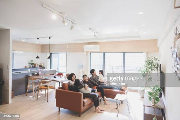 family relaxed on sofa at home - japan stock pictures, royalty-free photos & images