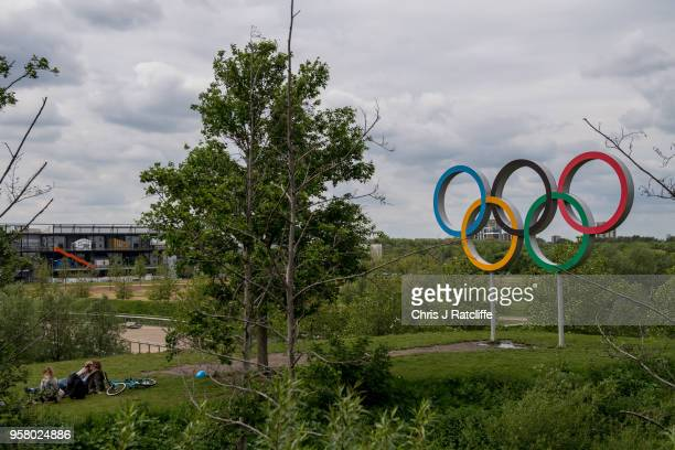 A family relaxes in front of the Olympic rings at Olympic Park as it is announced that Dame Tessa Jowell has died on May 13 2018 in London England...