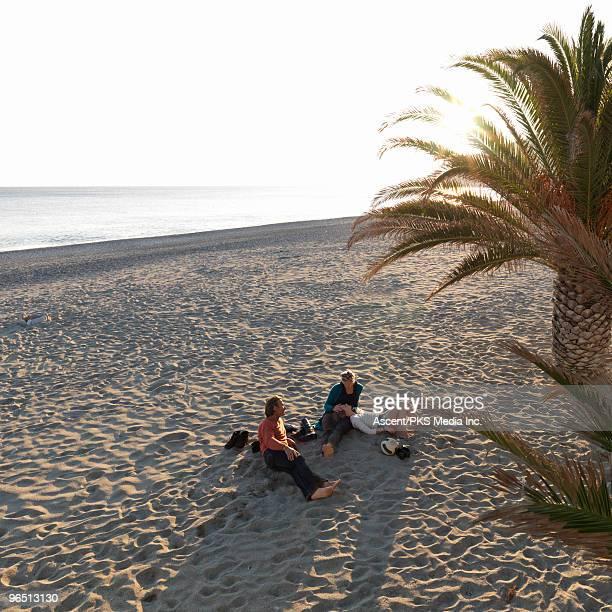 family relaxes on empty sand beach, off-season - fille de 12 ans photos et images de collection