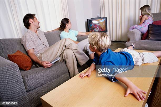 Family relaxing and watching television in the living room