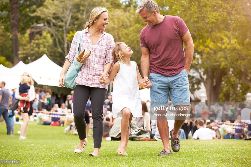 Family Relaxing At Outdoor Summer Event : Stock Photo