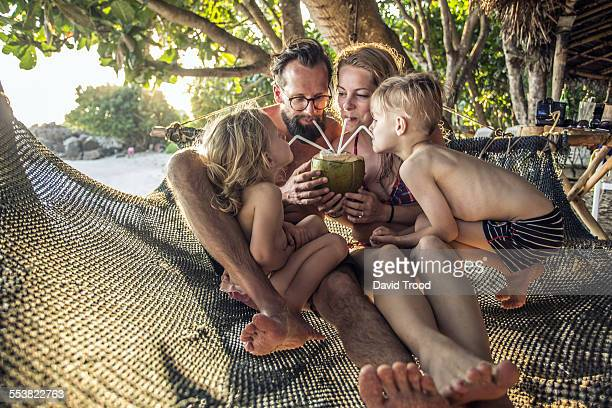 Family relaxing in hammock.