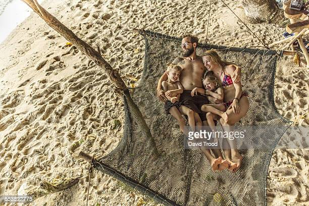 Family relaxing in hammock.