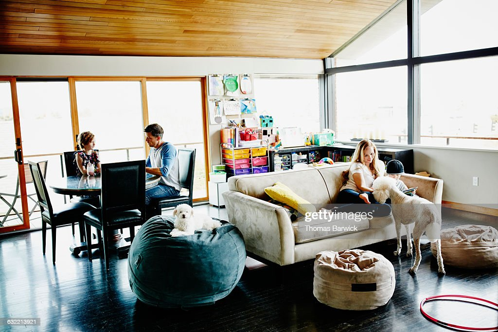 Family relaxing in living room of home : Stock Photo