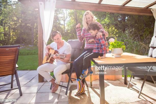 Family relaxing on backyard patio