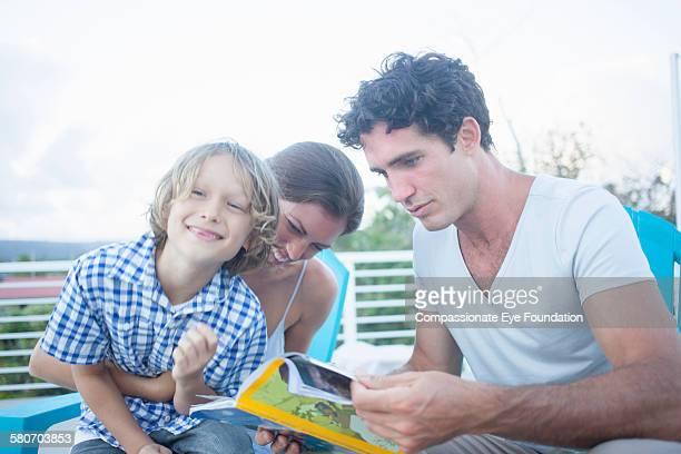 family relaxing on balcony - パホア ストックフォトと画像